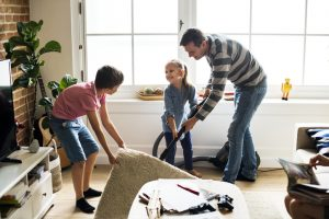 Kids helping their father with house chores