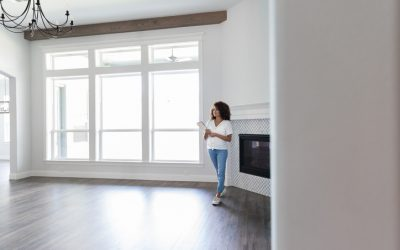 Mid adult woman looks around living room and makes plans.