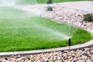 Automatic sprinklers watering lawn