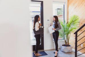 Just inside front door, realtor explains home's features